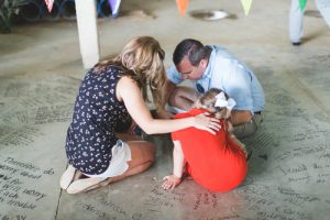 family-praying-over-the-foundation